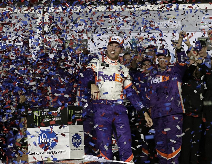Denny Hamlin celebrates in Victory Lane after winning the NASCAR Daytona 500 auto race at Daytona International Speedway, Sunday, Feb. 17, 2019, in Daytona Beach, Fla. (John Raoux/AP)