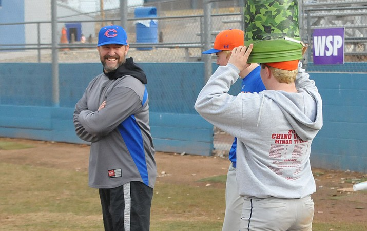 Chino Valley head coach Mark Middleton laughs at Mike Paulus' sense of humor at practice Feb. 15, 2019, in Chino Valley. (Doug Cook/Courier)