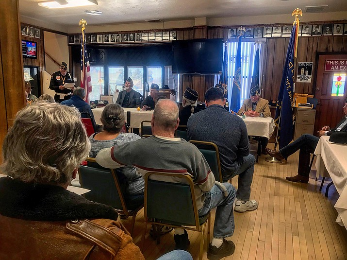 Those in attendance, at American Legion Post 6 on Feb. 10, listen to the story of four chaplains who gave their lives to saves hundreds of lives in World War II. These four chaplains died serving their country Feb. 3, 1943. (George Johnston/Courier)