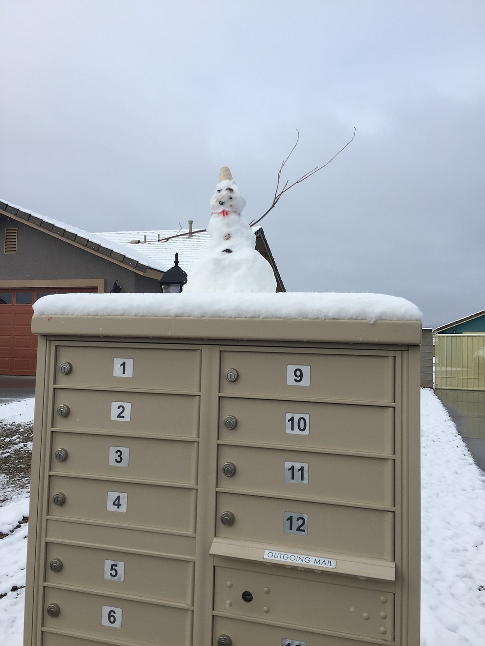 M. Myers and family took time to build a snowman on their mailbox. (Submitted photo by M. Meyers)
