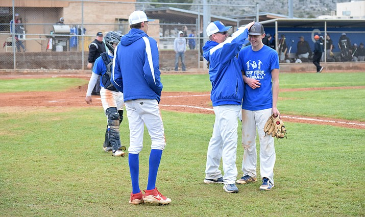 Camp Verde head coach Will Davis congratulates sophomore Mason Rayburn after he pitched against Williams in the Cowboys' scrimmage at home on Saturday. VVN/James Kelley