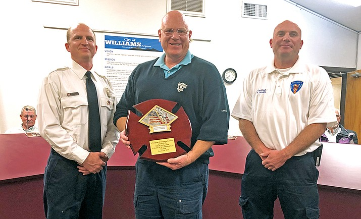John Moede (center) was honored by Williams Volunteer Fire Department Feb. 14 for his service with the department. (Wendy Howell/WGCN)