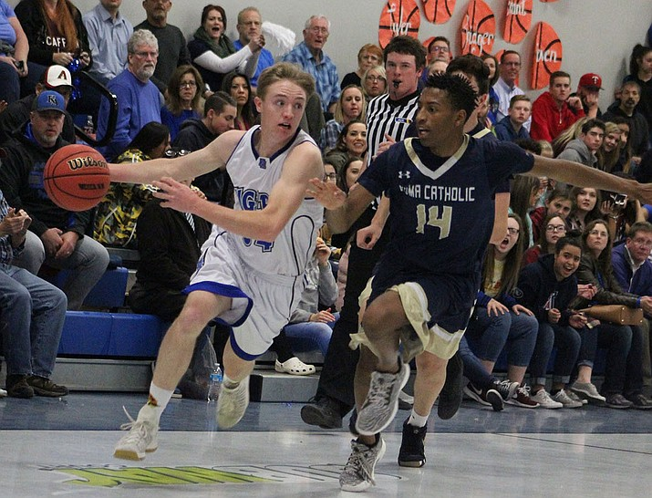 Aden Dunton and six other seniors played their final basketball game for Kingman Academy Saturday night in the second round of the 3A State Championship. The Tigers went 11-5 overall and 7-3 in their first year in the 3A West Region. (Daily Miner file photo)