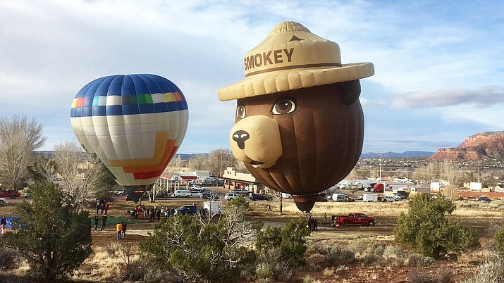 Crew members and volunteers from Kaibab National Forest help set up the Smokey Bear Balloon for the 5th Annual Balloons and Tunes Roundup in Kanab, Utah, Feb. 15. (Photo/Kaibab National Forest)