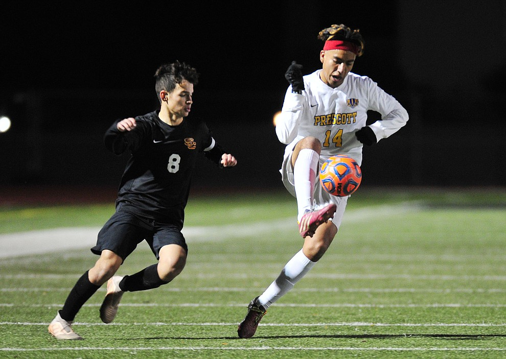 Prescott's Fernando Rodriguez battles for the ball as the Badgers take on the Salpointe Catholic Lancers in the Arizona Interscholastic Association 4A State Soccer Championship Tuesday, February 19, 2019 at Williams Field High School in Gilbert. (Les Stukenberg/Courier).