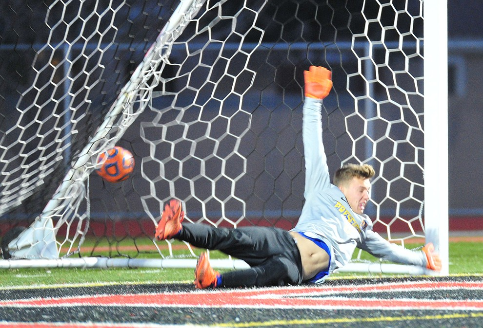 Prescott's Tobias Buettner just misses the stop on an early penalty kick as the Badgers take on the Salpointe Catholic Lancers in the Arizona Interscholastic Association 4A State Soccer Championship Tuesday, February 19, 2019 at Williams Field High School in Gilbert. (Les Stukenberg/Courier).