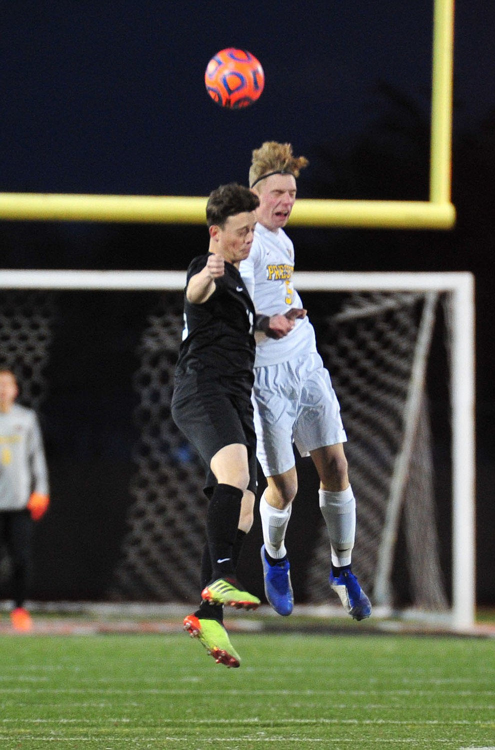 Prescott's Mathew Kaitschuck heads the ball as the Badgers take on the Salpointe Catholic Lancers in the Arizona Interscholastic Association 4A State Soccer Championship Tuesday, February 19, 2019 at Williams Field High School in Gilbert. (Les Stukenberg/Courier).