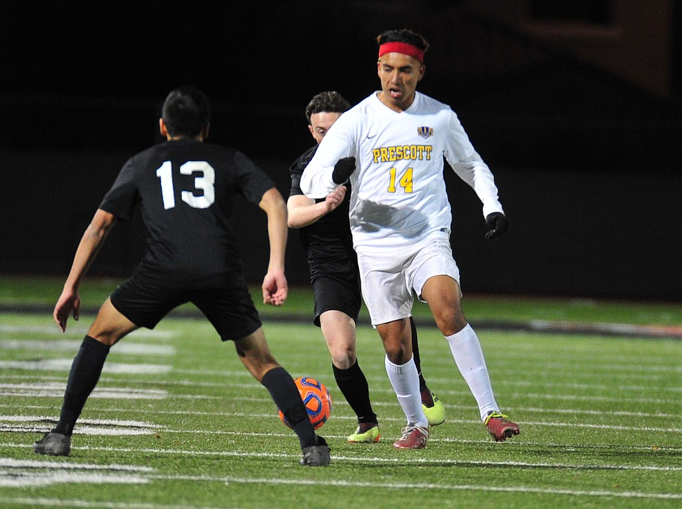 Prescott's Fernando Rodriguez brings the ball upfield as the Badgers take on the Salpointe Catholic Lancers in the Arizona Interscholastic Association 4A State Soccer Championship Tuesday, February 19, 2019 at Williams Field High School in Gilbert. (Les Stukenberg/Courier).