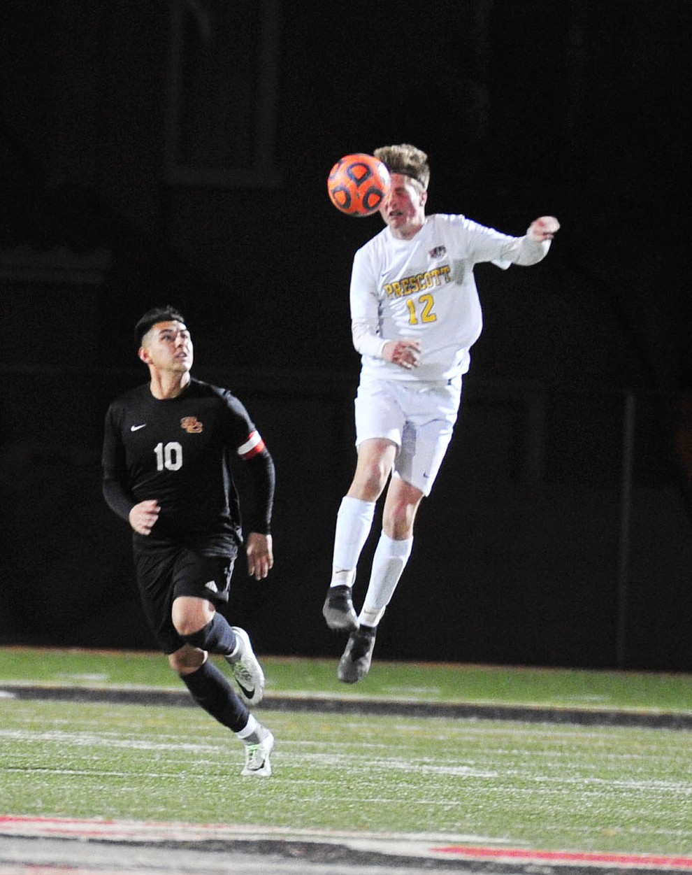 Prescott's Brayden Nelson heads the ball as the Badgers take on the Salpointe Catholic Lancers in the Arizona Interscholastic Association 4A State Soccer Championship Tuesday, February 19, 2019 at Williams Field High School in Gilbert. (Les Stukenberg/Courier).
