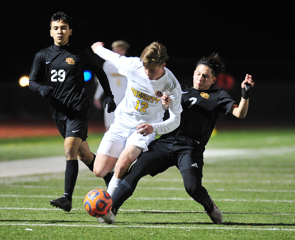 Prescott's Brayden Nelson gets taken down as the Badgers take on the Salpointe Catholic Lancers in the Arizona Interscholastic Association 4A State Soccer Championship Tuesday, February 19, 2019 at Williams Field High School in Gilbert. (Les Stukenberg/Courier).