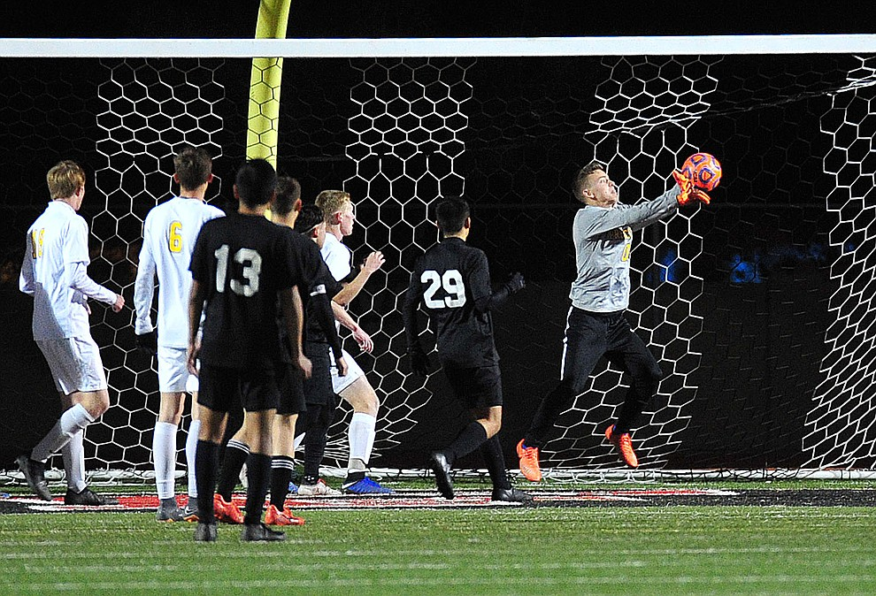 Prescott's Tobias Buettner makes a stop as the Badgers take on the Salpointe Catholic Lancers in the Arizona Interscholastic Association 4A State Soccer Championship Tuesday, February 19, 2019 at Williams Field High School in Gilbert. (Les Stukenberg/Courier).