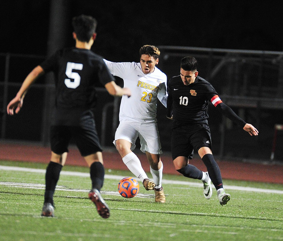 Prescott's Bryant Chavira battles for the ball as the Badgers take on the Salpointe Catholic Lancers in the Arizona Interscholastic Association 4A State Soccer Championship Tuesday, February 19, 2019 at Williams Field High School in Gilbert. (Les Stukenberg/Courier).
