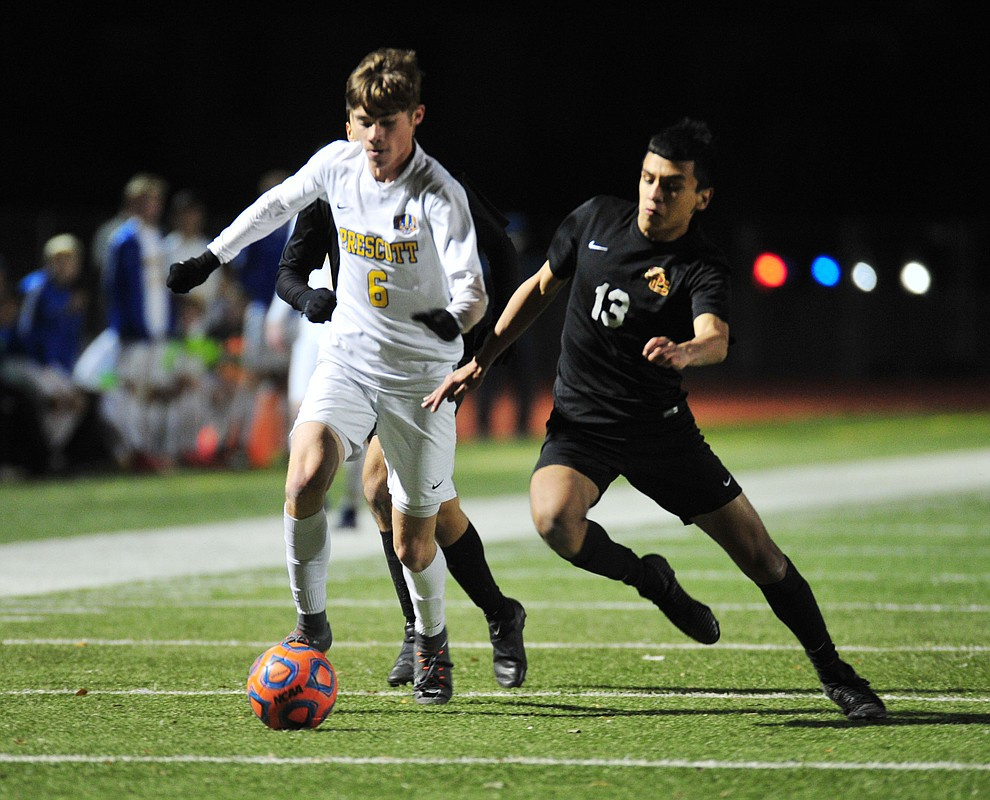 Prescott's Cade Tutrone drives the ball forward as the Badgers take on the Salpointe Catholic Lancers in the Arizona Interscholastic Association 4A State Soccer Championship Tuesday, February 19, 2019 at Williams Field High School in Gilbert. (Les Stukenberg/Courier).
