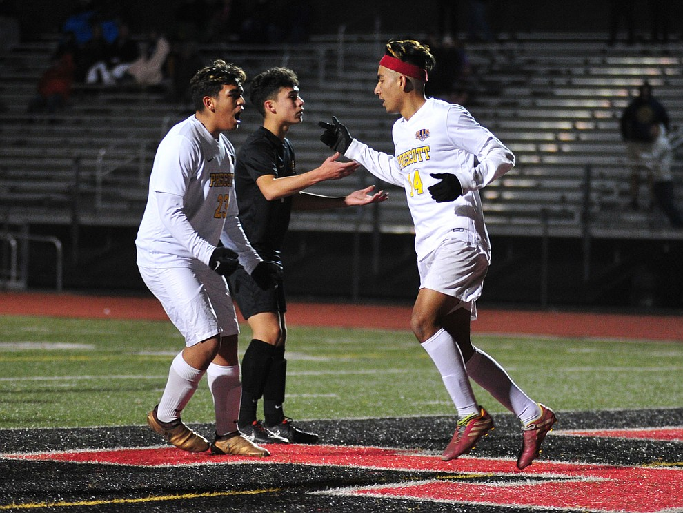 Prescott's Bryant Chavira, left, congratulates Fernando Rodriguez on his first half goal as the Badgers take on the Salpointe Catholic Lancers in the Arizona Interscholastic Association 4A State Soccer Championship Tuesday, February 19, 2019 at Williams Field High School in Gilbert. (Les Stukenberg/Courier).