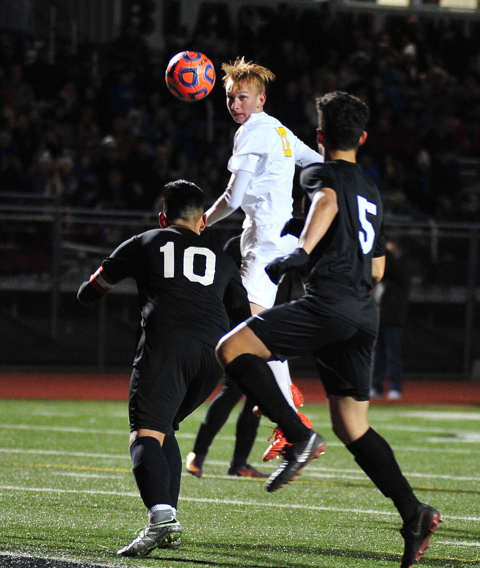 Prescott's Ryan Doyle heads the ball towards the goal as the Badgers take on the Salpointe Catholic Lancers in the Arizona Interscholastic Association 4A State Soccer Championship Tuesday, February 19, 2019 at Williams Field High School in Gilbert. (Les Stukenberg/Courier).