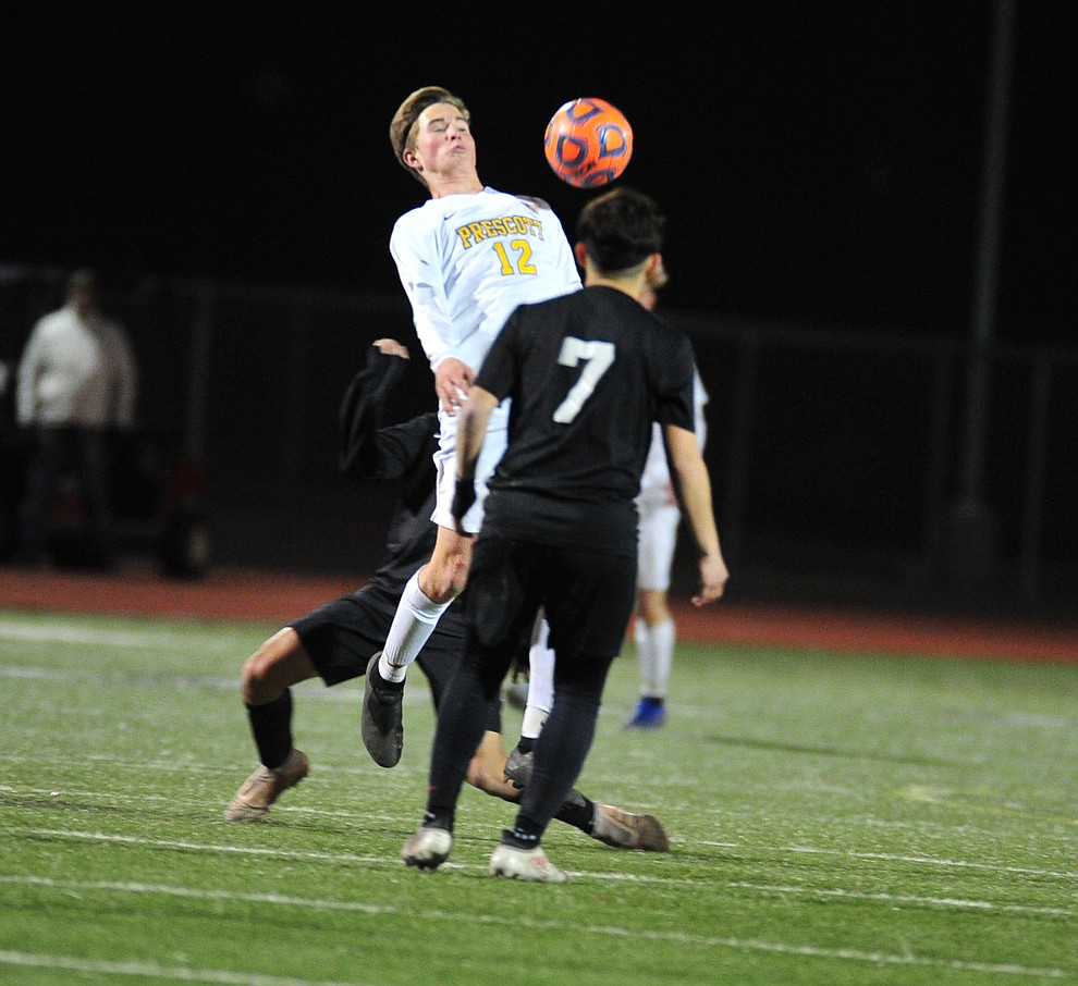 Prescott's Brayden Nelson tries to control the ball as the Badgers take on the Salpointe Catholic Lancers in the Arizona Interscholastic Association 4A State Soccer Championship Tuesday, February 19, 2019 at Williams Field High School in Gilbert. (Les Stukenberg/Courier).