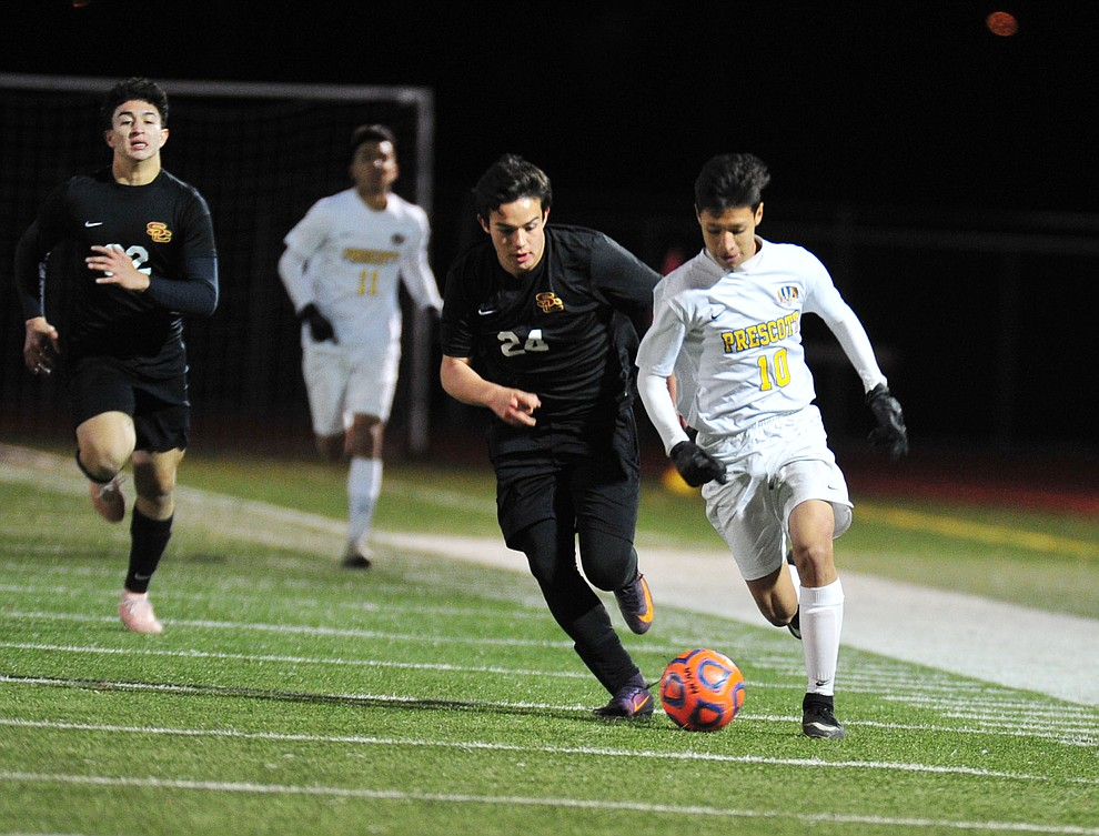 Prescott's Edgar Martinez drives the ball forward as the Badgers take on the Salpointe Catholic Lancers in the Arizona Interscholastic Association 4A State Soccer Championship Tuesday, February 19, 2019 at Williams Field High School in Gilbert. (Les Stukenberg/Courier).
