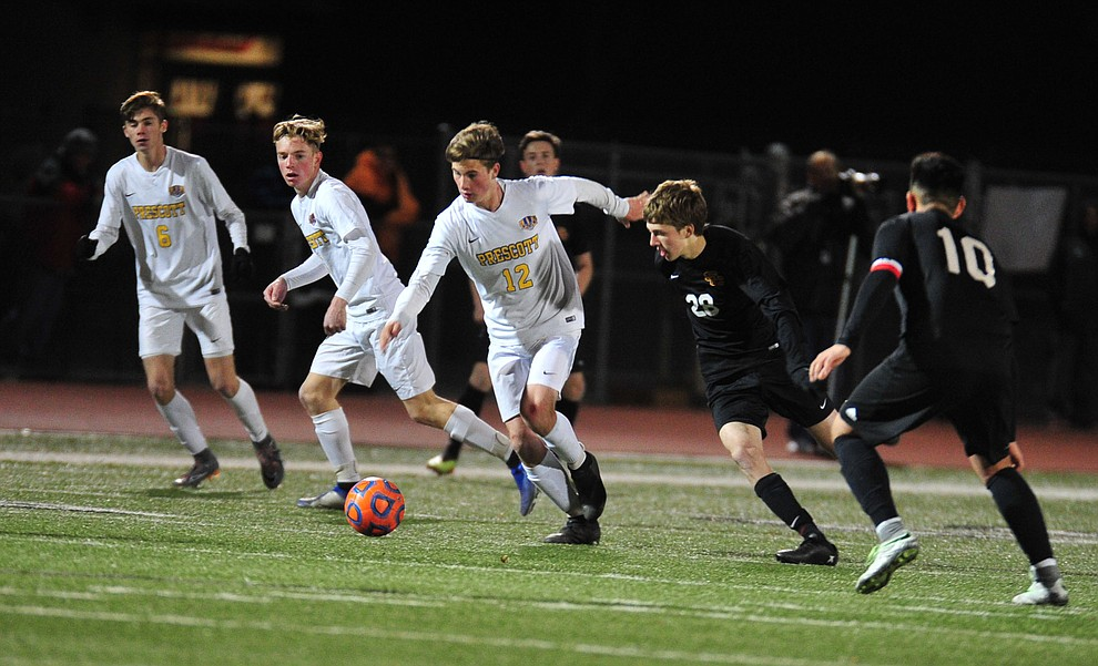 Prescott's Brayden Nelson drives the ball forward late in the game as the Badgers take on the Salpointe Catholic Lancers in the Arizona Interscholastic Association 4A State Soccer Championship Tuesday, February 19, 2019 at Williams Field High School in Gilbert. (Les Stukenberg/Courier).
