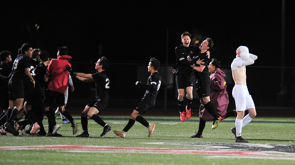 A Prescott player covers his head as the Badgers fell to the Salpointe Catholic Lancers 2-1 in the Arizona Interscholastic Association 4A State Soccer Championship Tuesday, February 19, 2019 at Williams Field High School in Gilbert. (Les Stukenberg/Courier).