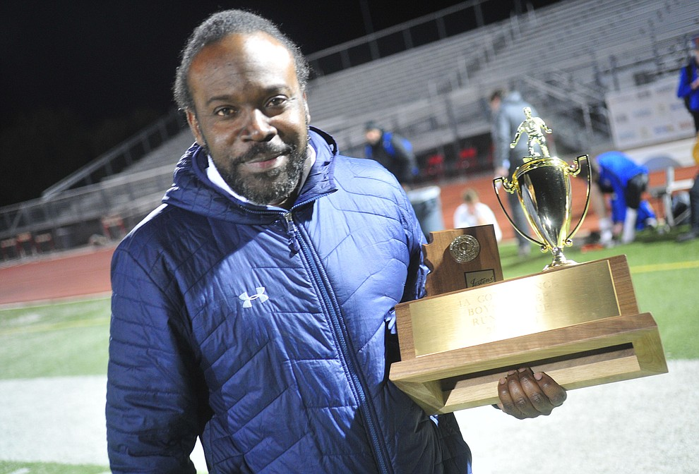 Prescott Head Coach Phil Reid holds the runnerup trophy after the Badgers lost to the Salpointe Catholic Lancers in the Arizona Interscholastic Association 4A State Soccer Championship Tuesday, February 19, 2019 at Williams Field High School in Gilbert. (Les Stukenberg/Courier).