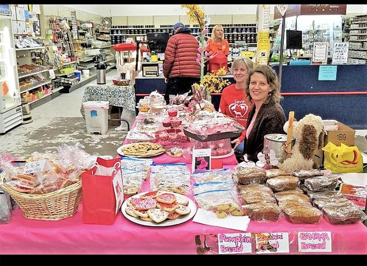 Angela Price, Diane Mansfield and Sally Bercham (not pictured) sell baked goods at Old Trail True Value Feb. 14. The volunteers were raising money for the SAVE-MTR animal shelter.  (Photo/Conne Duff)