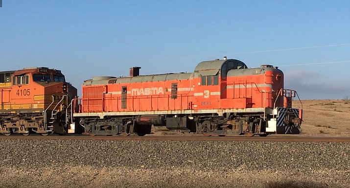 Magma Engine No. 3 on rear end of a train prepares to leave Amarillo, Texas on its way to Williams, Arizona to be displayed in the future Arizona State Railroad Museum. (Photo/Pete Kahon)