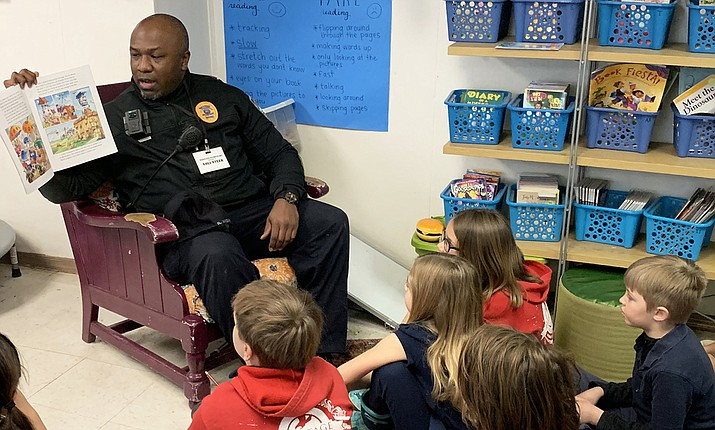 Williams Police Officer Robert Anderson reads to a classroom at Heritage Elementary School Feb. 13 as part of Love of Reading week. (Photo/Heritage Elementary School)