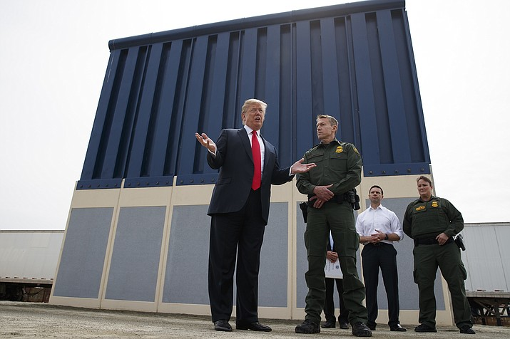 President Donald Trump talks with reporters March 13, 2018, as he reviews border wall prototypes in San Diego. (Evan Vucci/AP, File)