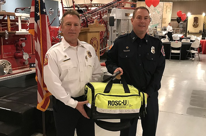 Central Arizona Fire and Medical Authority (CAFMA) Capt. Doug Niemynski and Fire Marshal Rick Chase with one of the agency's new mechanical chest compression devices Wednesday, Feb. 13, at the Hall of Flame Museum in Phoenix. (Central Arizona Fire and Medical Authority/Courtesy)