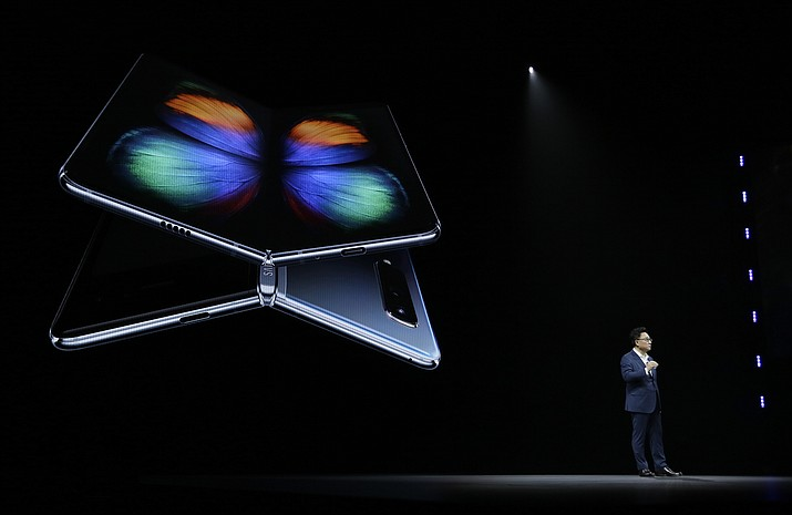 DJ Koh, Samsung President and CEO of IT and Mobile Communications, talks about the new Samsung Galaxy Fold smartphone during an event Wednesday, Feb. 20, 2019, in San Francisco. (Eric Risberg/AP)