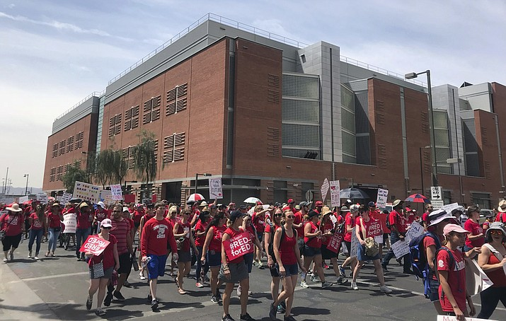 Teachers begin marching towards the Arizona Capitol on Thursday, April 26, 2018 in Phoenix. A House panel voted Monday to ask voters to sharply increase what they pay in sales taxes to fund public education. HCR 2024 would put a measure on the 2020 ballot to boost the current 0.6-cent sales tax earmarked for schools to a full penny. (Melissa Daniels/AP, file)