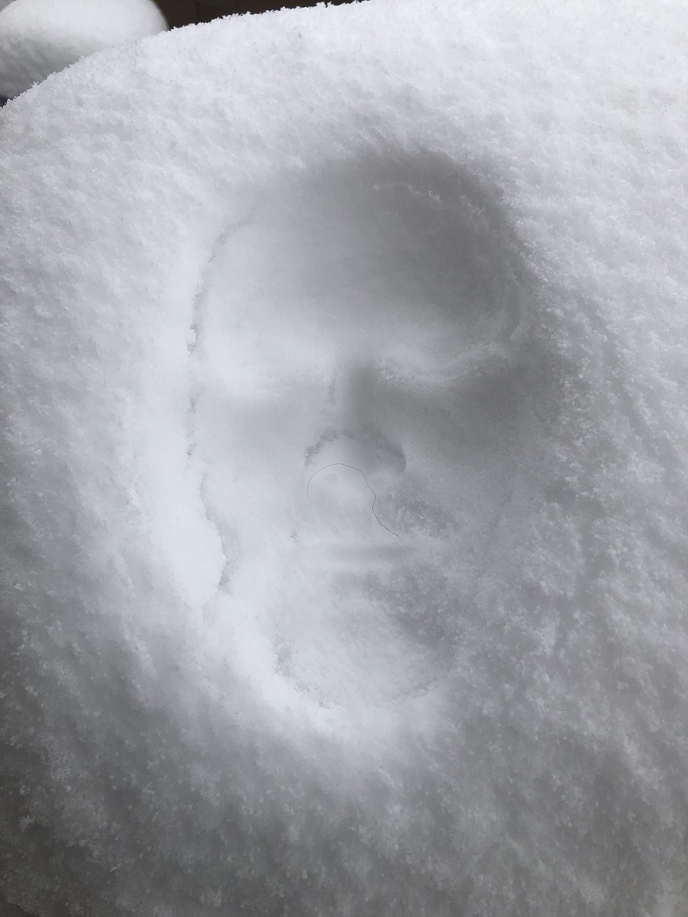Johnny Schmidt's snow face on the grill (Kristen Purol)