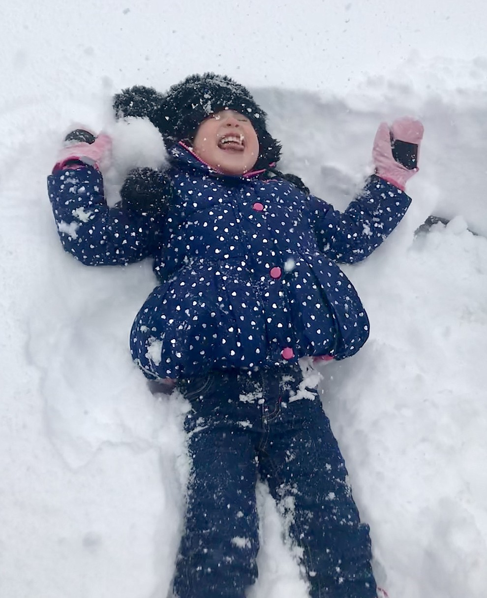 Making snow angels in our front yard in Yavapai Hills  by Kahla Ellis