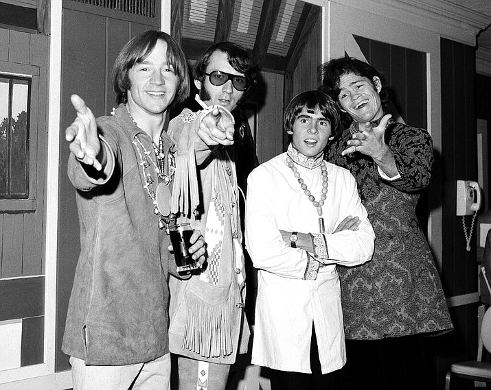 This July 6, 1967 file photo shows, from left, Peter Tork, Mike Nesmith, David Jones and Micky Dolenz of the musical group The Monkees at a news conference at the Warwick Hotel in New York. Tork, who rocketed to teen idol fame in 1965 playing the lovably clueless bass guitarist in the made-for-television rock band The Monkees, died Thursday, Feb. 21, 2019, of complications related to cancer, according to his son Ivan Iannoli. He was 77. (AP Photo/Ray Howard, File)