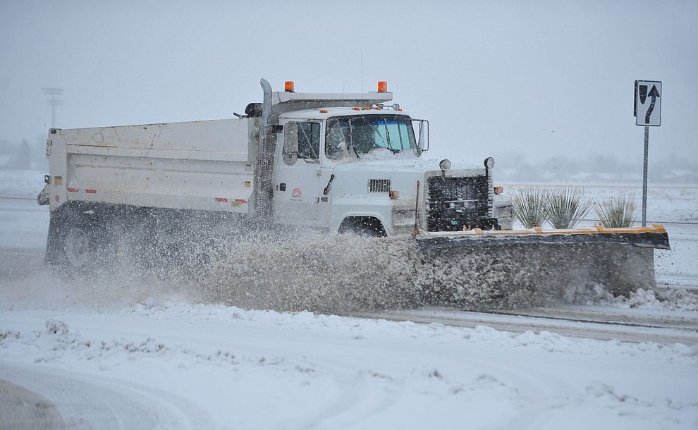 Prescott Valley snowplows were on Glassford Hill Road as the predicted snowfall Thursday, Feb. 21, 2019 hit the Prescott Valley area. (Les Stukenberg/Courier).