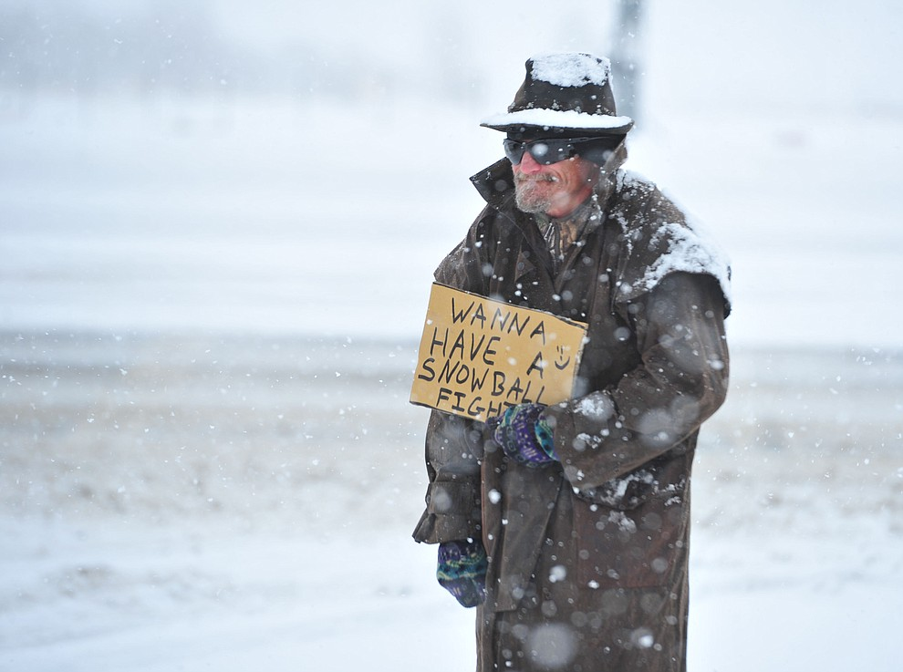 Toby Chaney had a fun with snow on the cormer of Lakeshore Drive and Glassford Hill Road as the predicted snowfall Thursday, Feb. 21, 2019 hit the Prescott Valley area. (Les Stukenberg/Courier).
