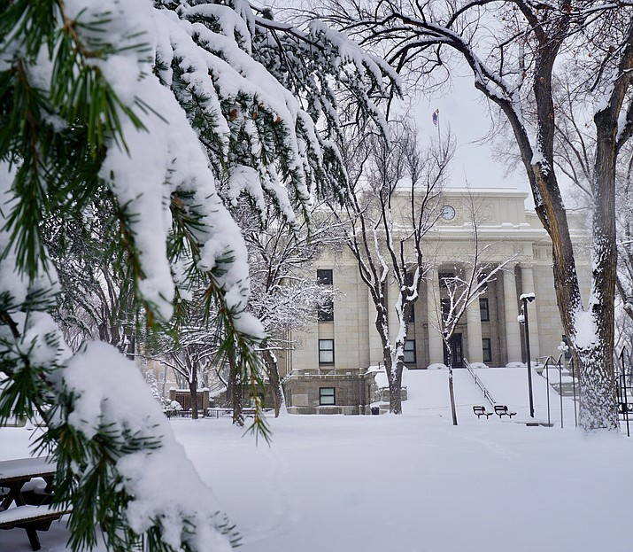 "With 12 inches of snow already accumulated on the ground before 1 p.m., and the condition of area roads ""degrading"" rapidly, Prescott Mayor Greg Mengarelli signed an emergency proclamation Thursday, Feb. 21."