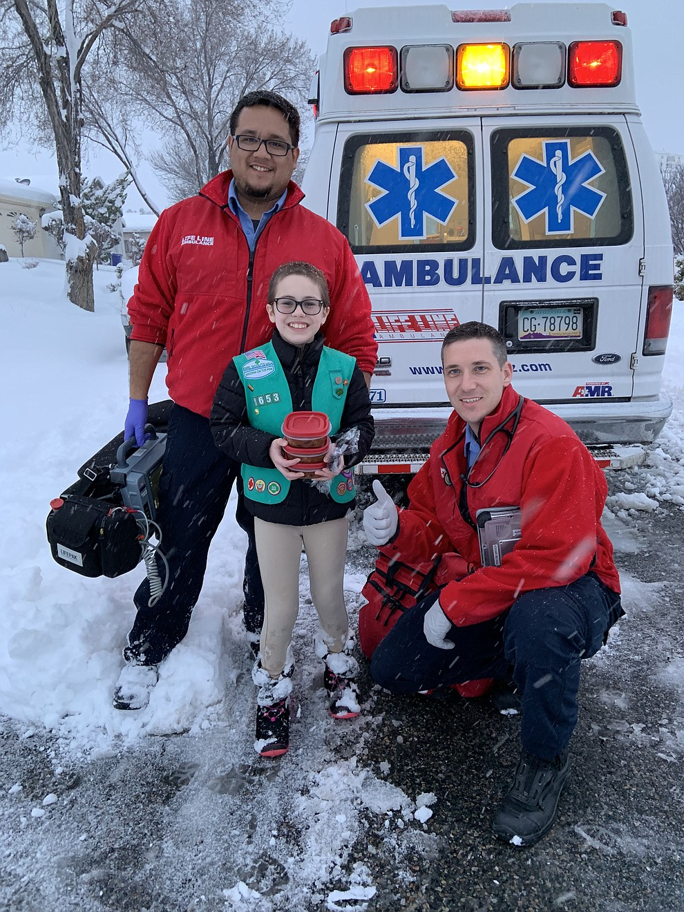 Girl Scout delivers chili to Lifeline crew. Cadence Menei, 11, shares a homemade meal to Prescott crew who braved the weather to respond to a neighborhood call. (Stephanie Menei)