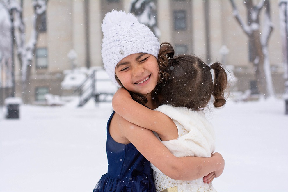 Kirra and Bethany enjoying the snow at the courthouse. (Amanda Williams)