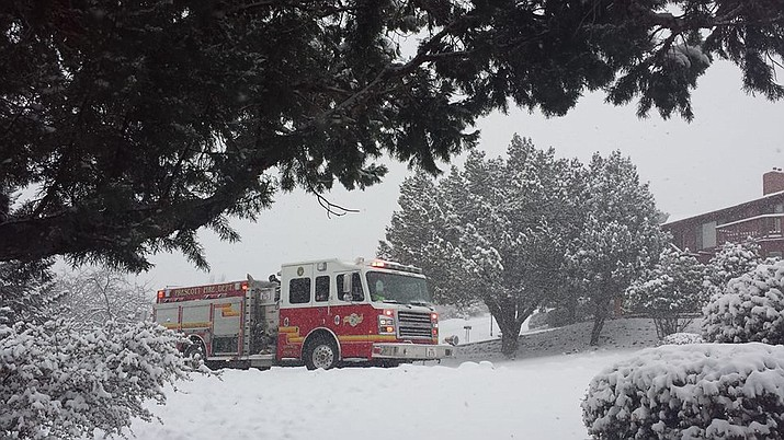 Prescott Fire Department answers a snow-storm emergency Call in the Yavapai Hills neighborhood on Thursday, Feb. 21, 2019. (Judy Balda/Courtesy)