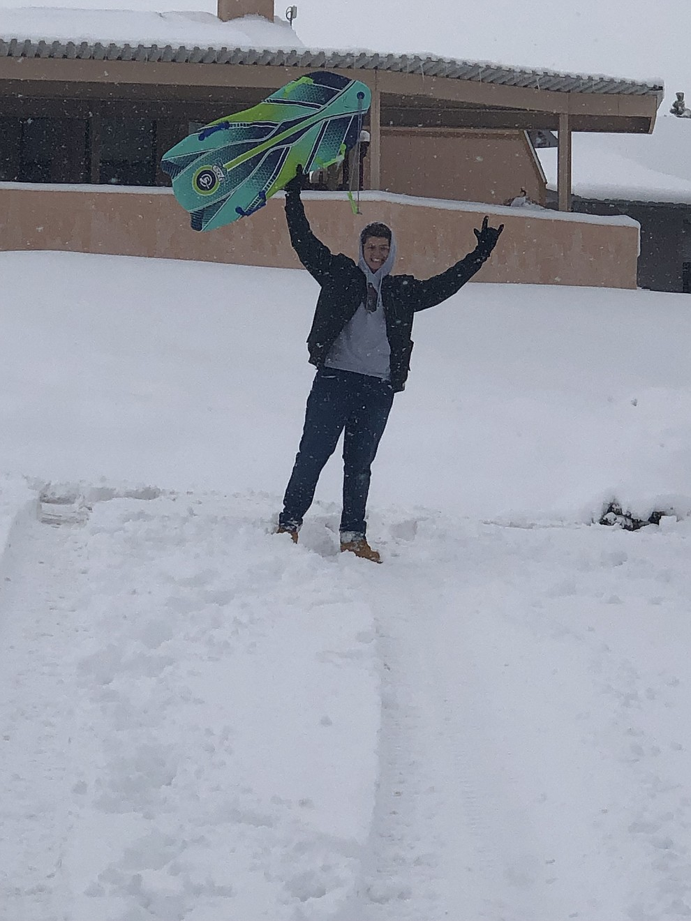 Jesse Vallejo playing in the snow