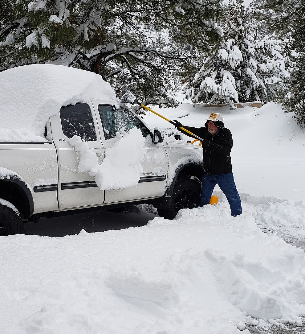 Thursday 2/21/19, digging out.My husband Gary trying to uncover our tundra in our driveway