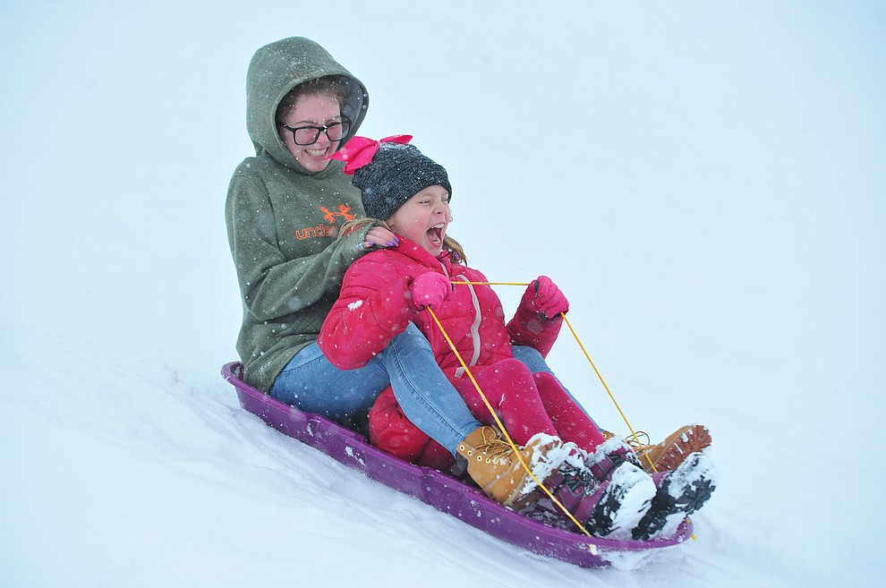 Mattison and Riley enjoy a sled trip down the hill at Mountain Valley Park in Prescott Valley Friday, Feb. 22, 2019