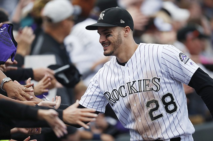 Fans congratulate Colorado Rockies third baseman Nolan Arenado after a game against Washington on Sunday, Sept. 30, 2018, in Denver. Arenado signed a $26 million, one-year contract to avoid arbitration over the winter. (David Zalubowski/AP, File)