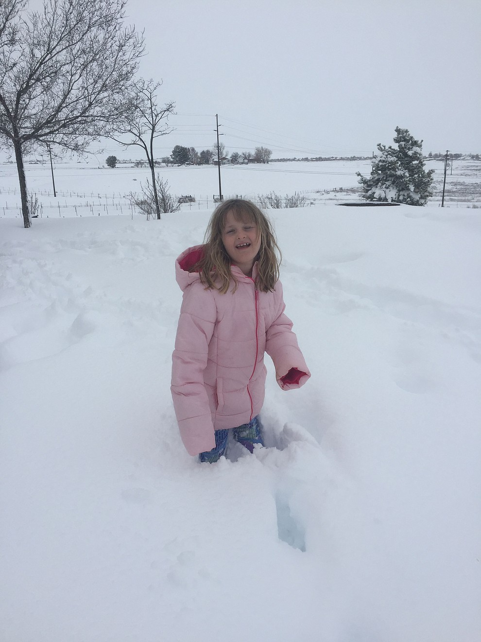 This girl can't get enough of the snow ! Chino valley