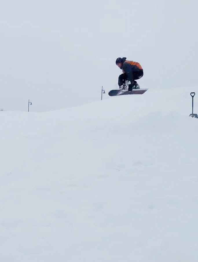Morgan Palmer-Lacey getting a little airtime while grabbing his snowboard!