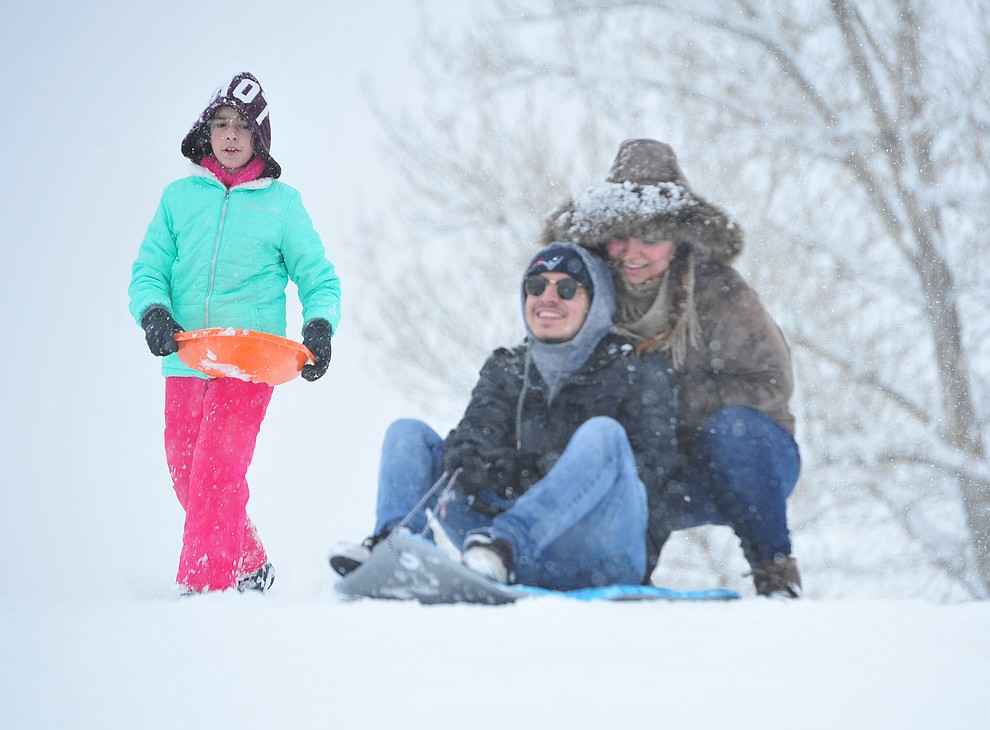 Briseis Rendon, Chris Pedraza and Giselle Martinez enjoy sledding at Mountain Valley Park in Prescott Valley Friday, Feb. 22, 2019. (Les Stukenberg/Courier)