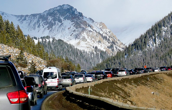 Traffic backs up on Interstate 70 on Jan. 7, 2018, near Silverthorne, Colo., a familiar scene on the main highway connecting Denver to the mountains. Heavy ski traffic along the interstate has been common for years, but Colorado's recent population boom is making it increasingly challenging for transportation officials who deal with a bare-bones budget. (Thomas Peipert/AP, File)