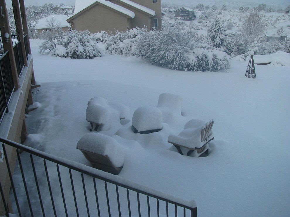 This was in our backyard during this incredible snow storm. This reflects our 4 Adirondack chairs and an outdoor fire pit in our little flagstone area below our deck.