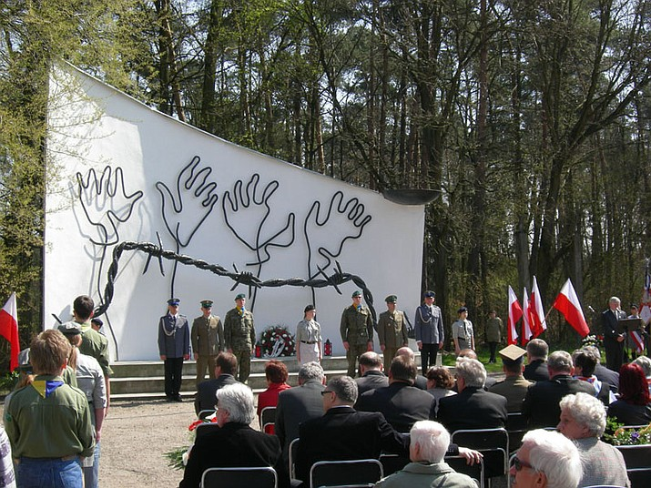 Ceremony at the former Judenlager of Blechhammer during the 65th anniversary of the liberation of the nazi camps. The memorial is at the front. (Photo by Jacques Lahitte [CC BY 3.0] via Wikimedia Commons)